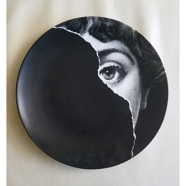 Fornasetti Tema E Variazioni Plate, Number 145, The iconic image of Lina Cavalieri, Atelier Fornasetti. A variation of...