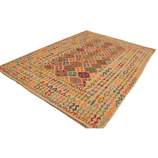 """""""Add a touch of elegance to your home with this casual chic hand woven Tribal Kilim wool rug. Constructed on a loom by..."""