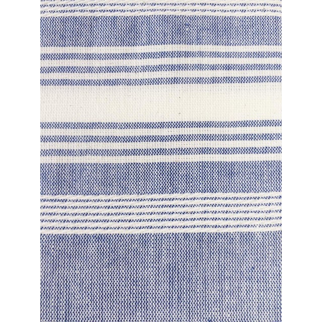 """Blue and white chambray kitchen towel, handwoven by artisans in Guatemala. 100% Cotton 24""""x31"""""""