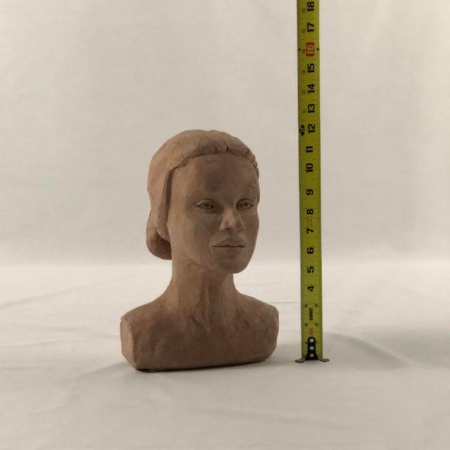 Clay bust by artist M. Schultz.