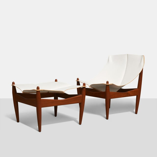 A rare chair and ottoman by Illum Wikkelso for CF Christensen. Model #272 in solid teak and saddle leather.