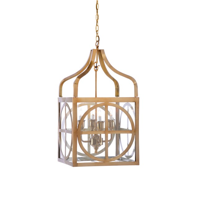 This is the Sherman lantern by Wildwood Lamps. The piece features a brass finish.