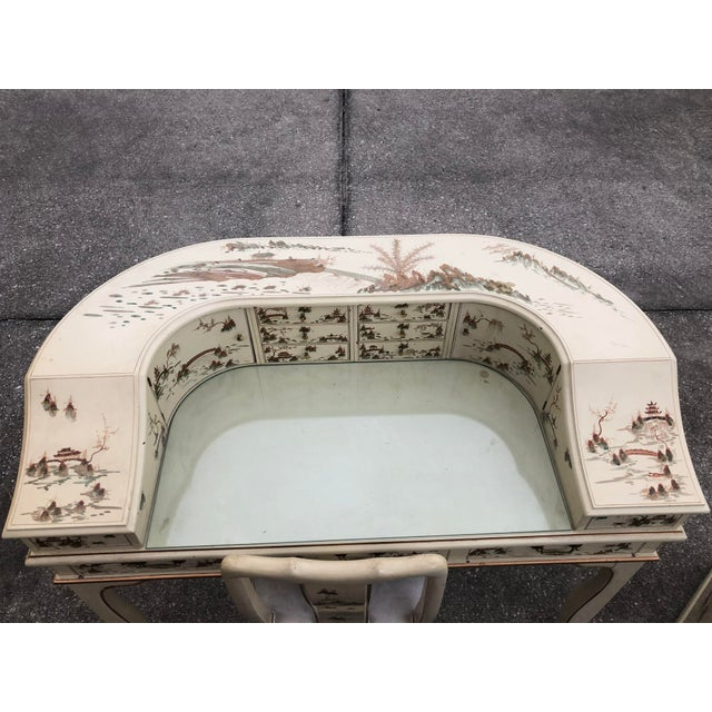 Great quality desk and chair lacquered in a off-white and gold trim. Decorated in handpainted Chinese houses and trees....
