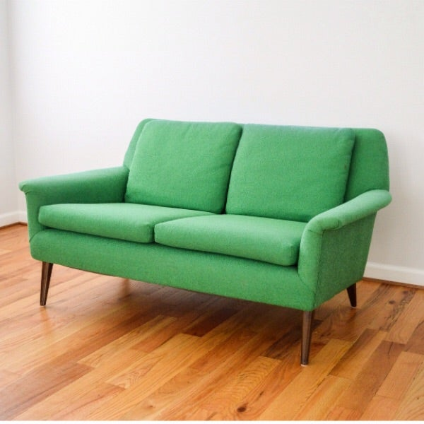 This loveseat from the 1960s attributed to Folke Ohlsson by Dux has classic mid-century modern styling and wonderful...