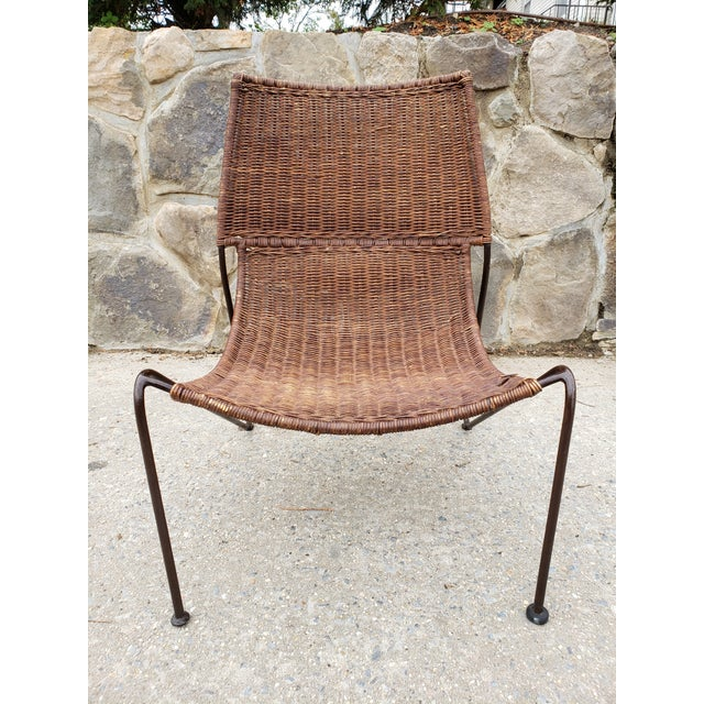 Mid Century Modern Frederick Weinberg sling scoop caned rattan seat and wrought iron frame lounge chair. This very unique...