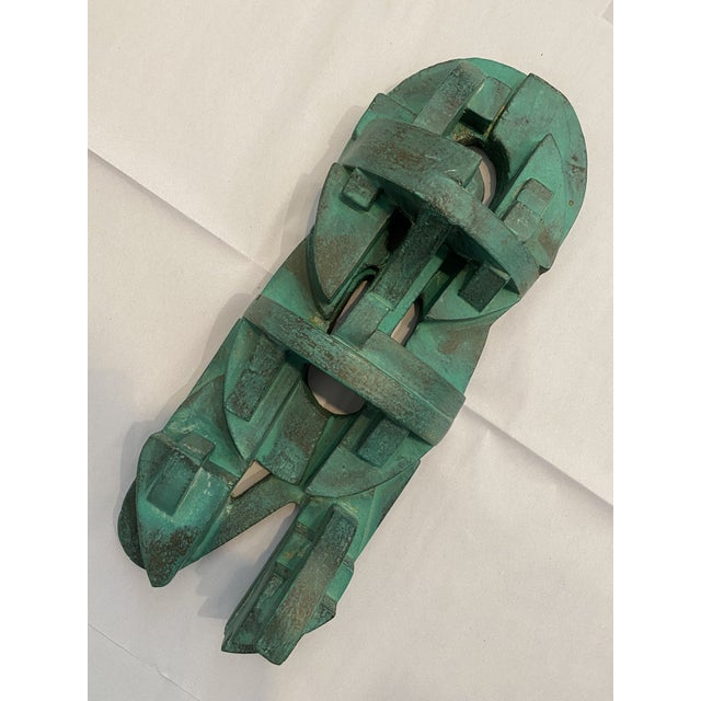 Minimalist abstract three dimensional wall sculpture in a patina 'color' green. Made of plaster.