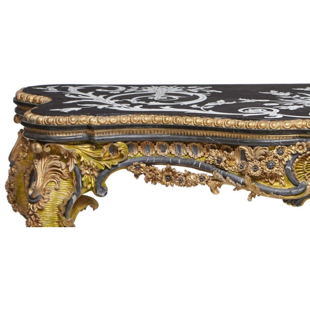 Highly impressive Italian Rococo style carved marble and gilt composition console with inlaid and veneered marble top,...