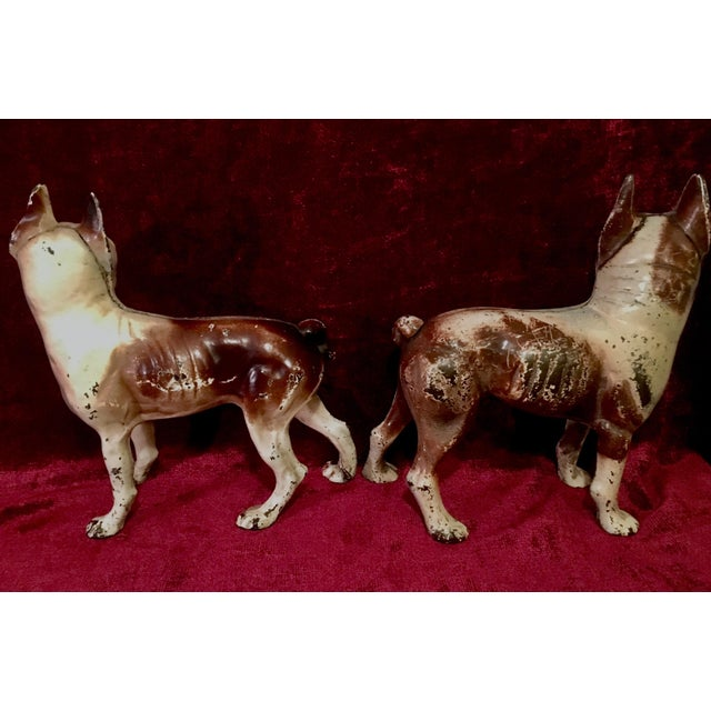 Matched pair of iconic Hubley Boston Terrier cast iron doorstops in early brown/beige color theme. Twice authenticated (in...