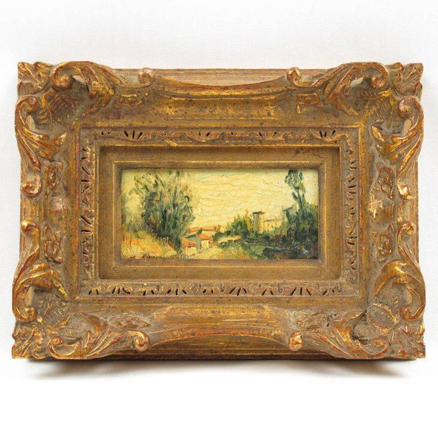 Lovely miniature painting mounted in a large detailed hand-carved gilt frame. Oil on wood panel depicting a Mediterranean...