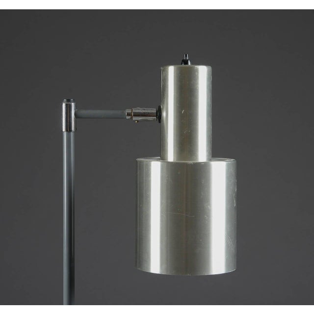 A floor lamp by Jo Hammerborg for Fog and Morup, Denmark, circa 1960s. Made of aluminum and brown grey lacquered metal,...