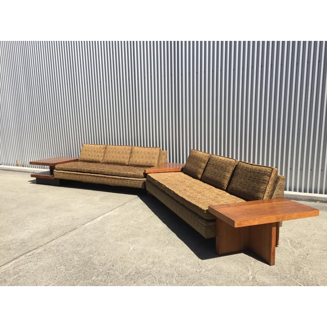1960s MB Designs Sectional. Walnut and upholstery. Slim lined seating unit trimmed with walnut reveal around perimeter....