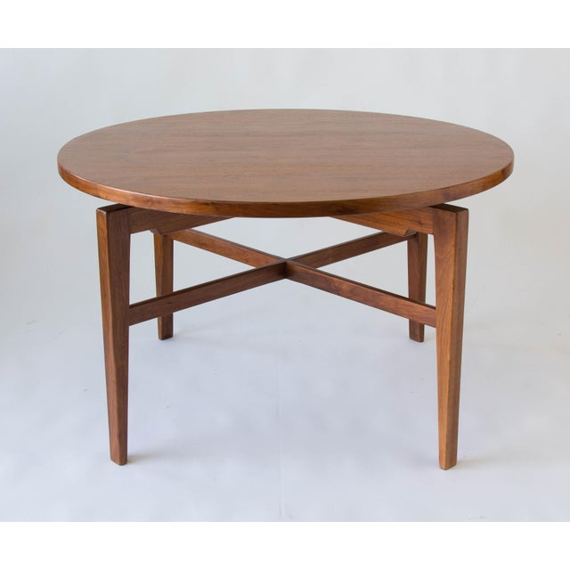 """A walnut game or card table by Jens Risom that rotates on a central mechanism for a """"Lazy Susan"""" effect. There is a hidden..."""