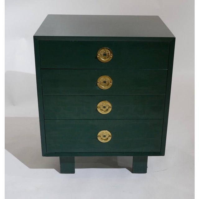 A vintage pair of George Nelson for Herman Miller chests of drawers done in green lacquer with Asian inspired brass pulls....