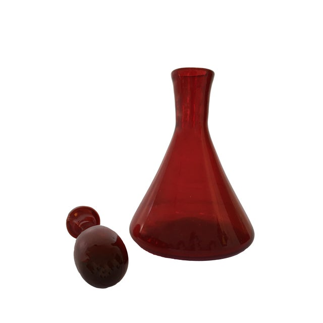 Vintage mid-century art glass decanter with deep & rich crimson coloring. Excellent condition.