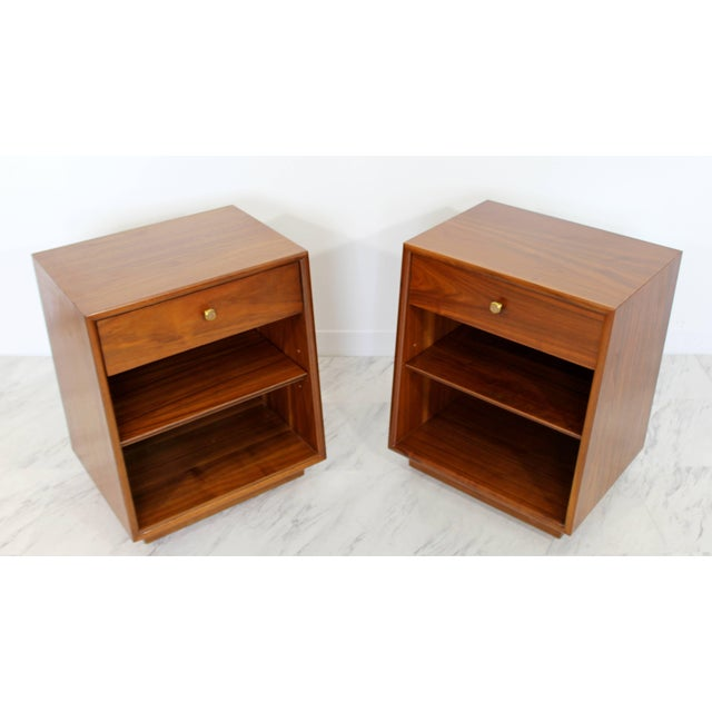 For your consideration is a phenomenal pair of walnut nightstands, with one drawer each that have brass and wood knobs, by...