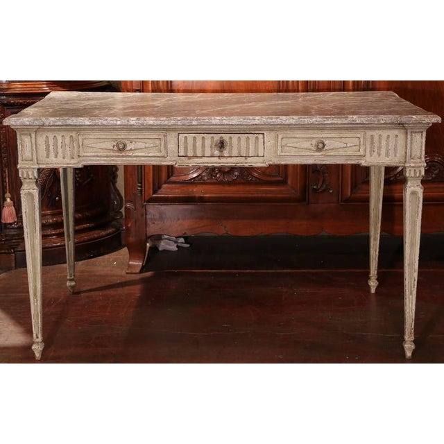 This elegant, antique lady's writing desk was carved in northern France, circa 1860. Carved on all four sides, the table...
