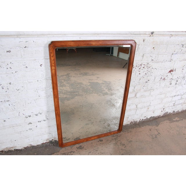 A nice oak beveled mirror by Henredon. The mirror has a clear reflection and nice oak frame. The frame has nice rounded...