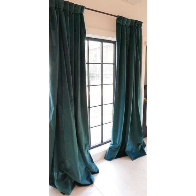 Gorgeous pair of custom curtains in deep blue-green velvet fabric. These have been lined and pleated. There is an...