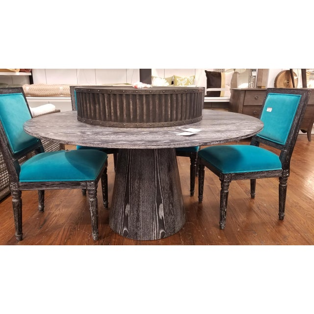 "Round black cerused oak dining table with a base of 59"" D tapering top"
