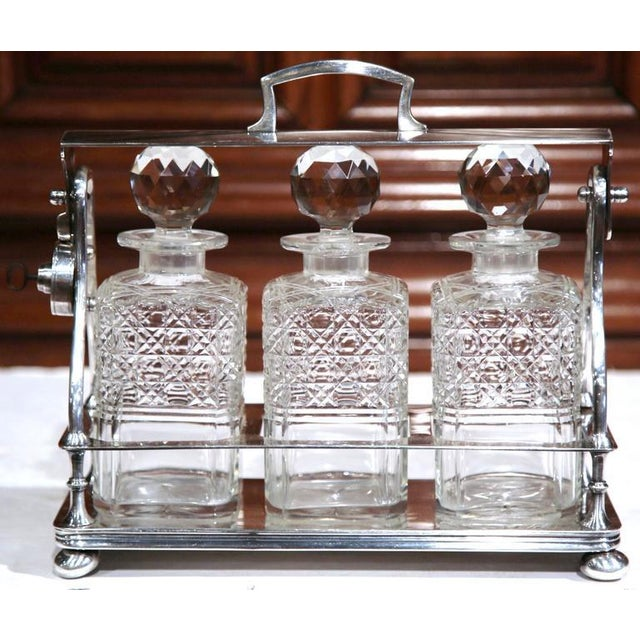 Entertain in style with this beautifully crafted, antique Tantalus from England. Crafted, circa 1860, the bar accessory is...