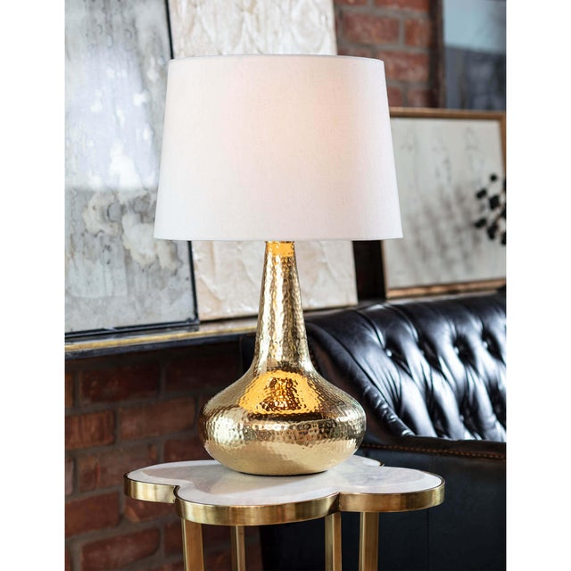 We're crazy for metallics in Taj metal table lamp, finished in a bright pop of Polished Brass. A streamlined silhouette...