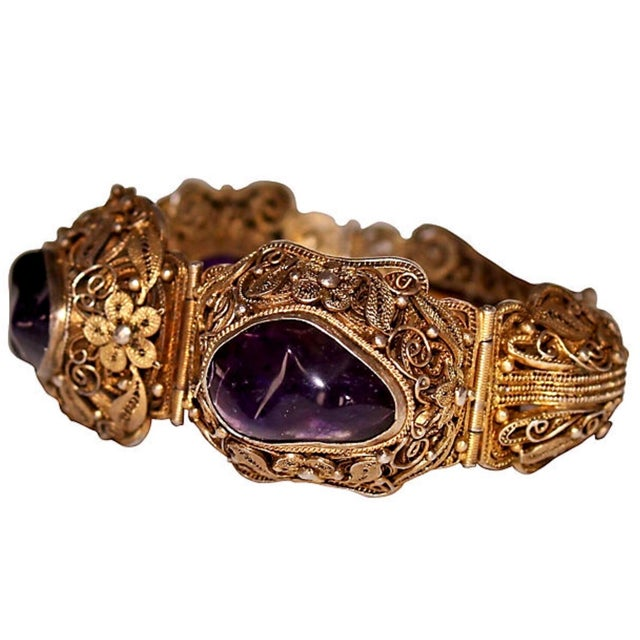 Circa 1940s to 1950s ornate gold-plated sterling silver bracelet with a lot of beautiful filigree detail. It is bezel set...