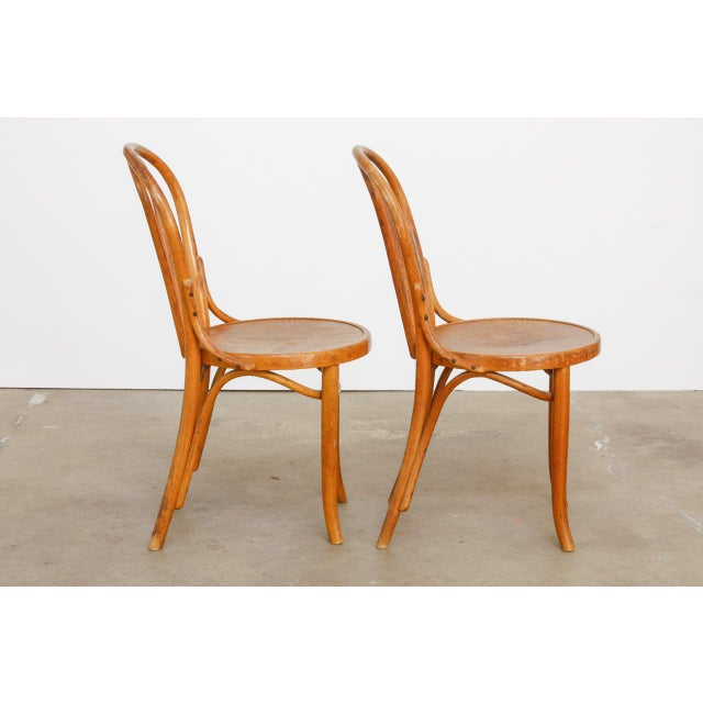 Iconic original pair of Michael Thonet's design number 18 bentwood Viennese cafe chairs. Produced at the factory in...