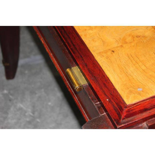 Offered is a French Art Deco designer sycamore & mahogany dining table with 2 leaves. size 70.25ʺW × 39.25ʺD × 30.0ʺH...