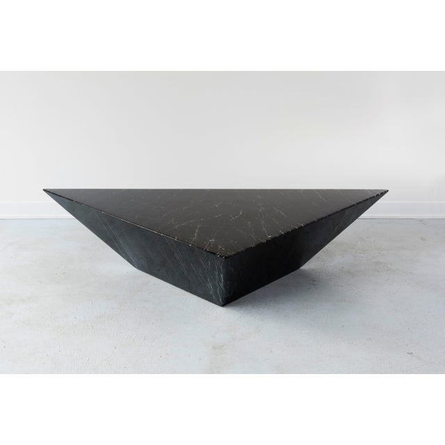 A circa 1980s geometric coffee table made of fiberglass with faux marble detail.