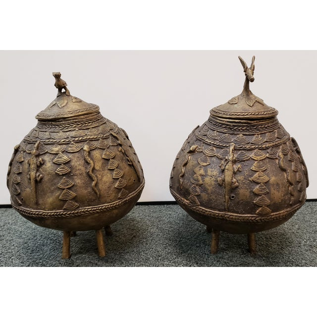 """Up for sale is a Pair of Mid 20th Century Ashanti Brass Kuduo Pots from Ghana! The one on the left measures 9 1/4"""" tall...."""