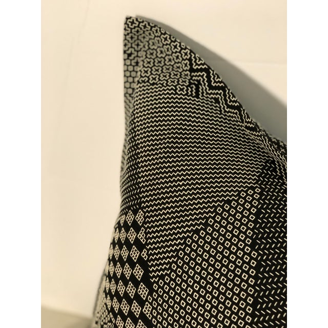"""Boho Chic pair of 20"""" square pillows of black fabric with white geometric stitching in patchwork style sections. The..."""