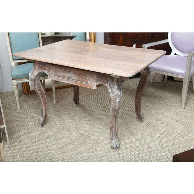 A lovely table in limed white oak with one drawer and carved cabriole legs. The table, in the Louis XV style, can be used...