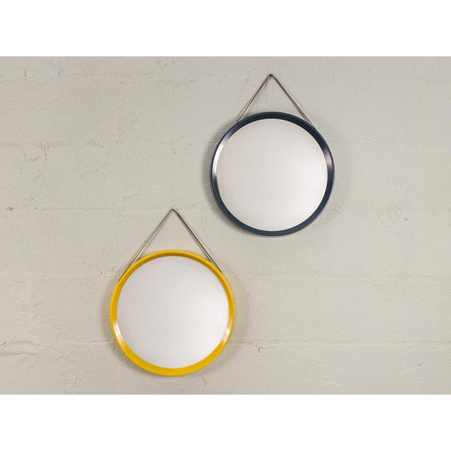 Vintage 1960s Danish Modern circular mirror with navy blue frame and leather hanging straps. Mirror is in very good...