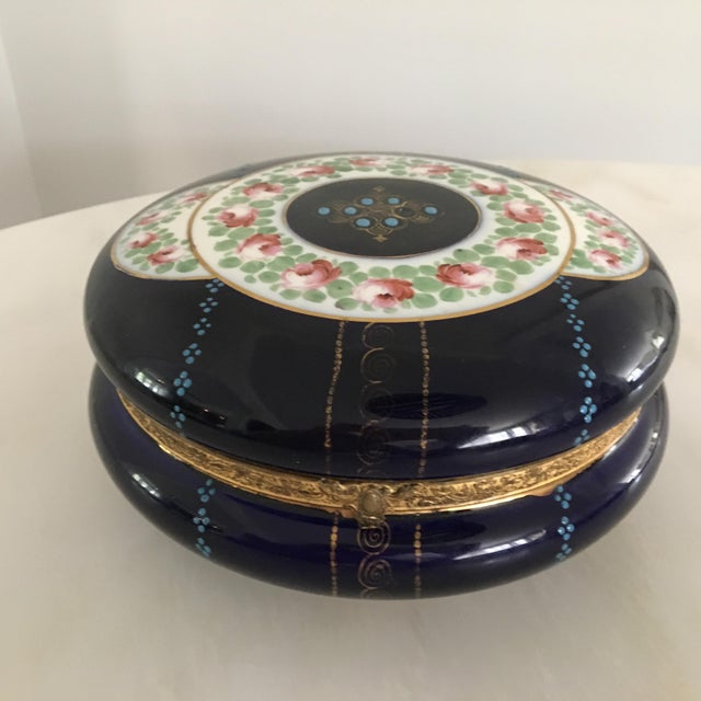 Stunning hand painted French dresser/ jewelry porcelain box with a hinged lid. It is a rich cobalt blue with hand painted...
