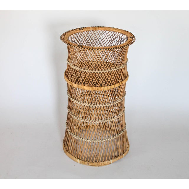 Bohemian style vintage wicker plant stand with a black geometric pattern on top. No makers mark. Minor age wear.