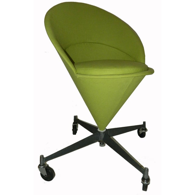 """A vintage, Verner Panton cone chair from Denmark. Newly reupholstered in green. Seat, 24""""H."""
