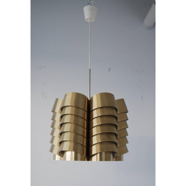 """A pendant by Hans-Agne Jakobsson, Markaryd, Sweden, circa 1960. Made of brass. Diameter 16"""", H- 13.5"""". Existing wiring,..."""