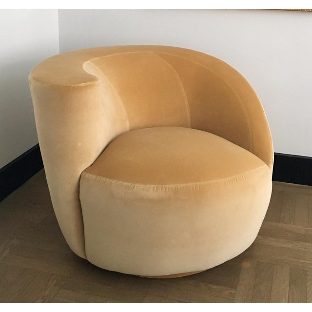 Glamorous and dramatic, Vladimir Kagan's (for Directional) Nautilus swivel chair is offered for sale. The chair is newly...