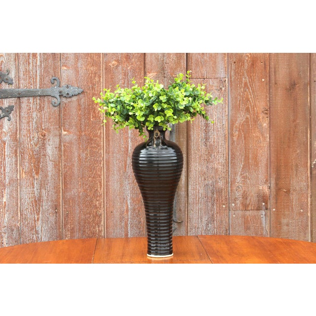 A Tang style glazed earthenware vase with a gorgeous ebony glaze, that features a shaped pour lip with a charming rooster...