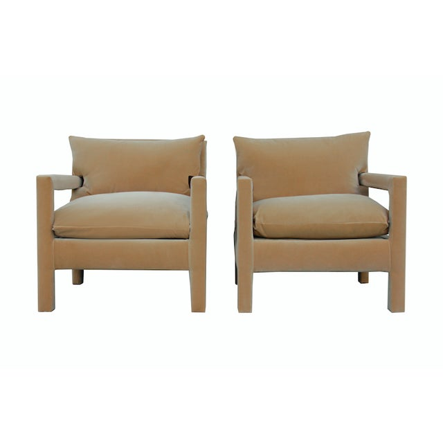 Stunning pair of 1970's style Parson Lounge Chairs by Milo Baughman, newly upholstered in camel taffy velvet.