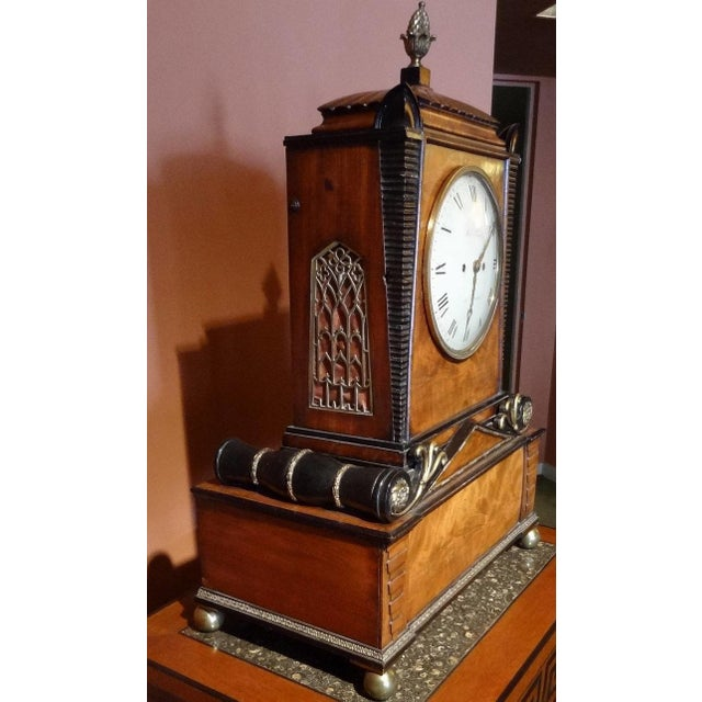 A 19th century English Regency six-tune musical clock, with the movement signed Robert Roskell, Liverpool, and the case...