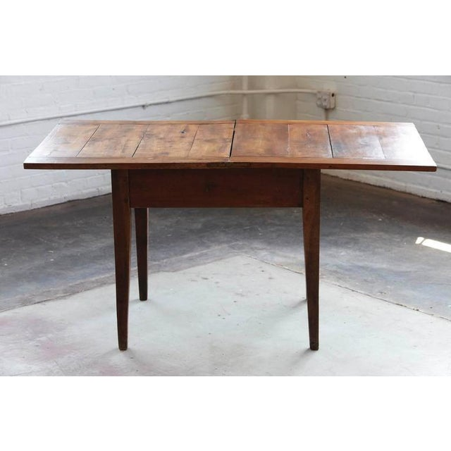 Antique maple card table with folding top and turnable mechanism on hinges. Solid construction, great patina. Table dates,...