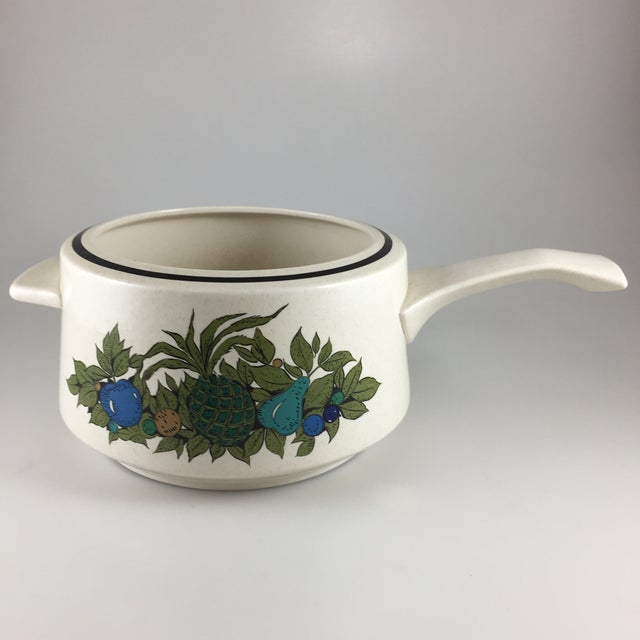 This fondue pot is in excellent condition. No chips or cracks. Description: Temperware, Blue, Green & Tan Fruit Pattern:...