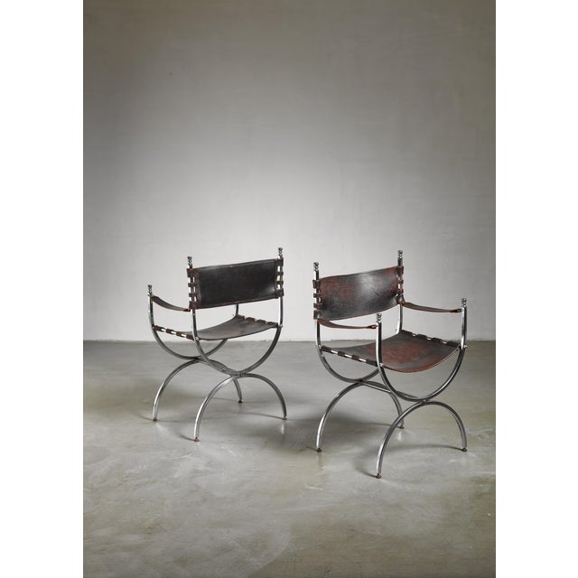 A pair of Maison Jansen attributed curule shaped chrome side chairs with very dark brown, close to black, leather.