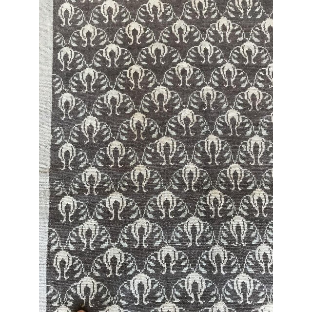"""Elegant brown continuous pattern in this """"Remy"""" rug."""