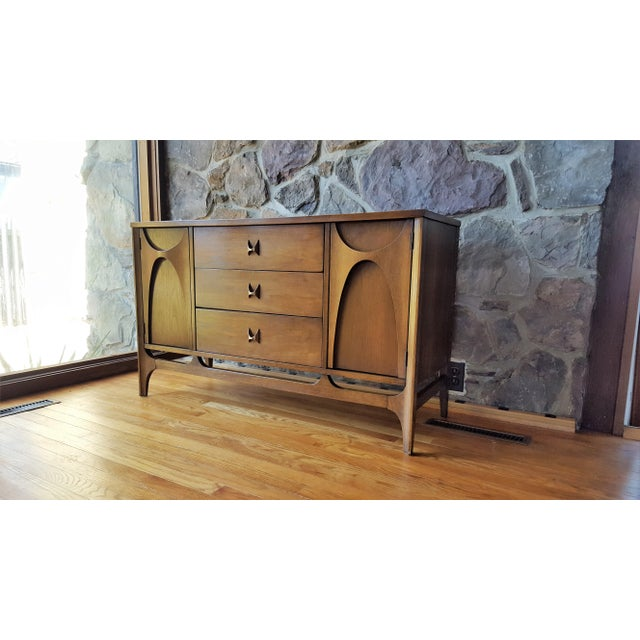 """This classic Broyhill Brasilia sideboard has a width of 46"""" - It is made of walnut. Age consistent wear and patina."""