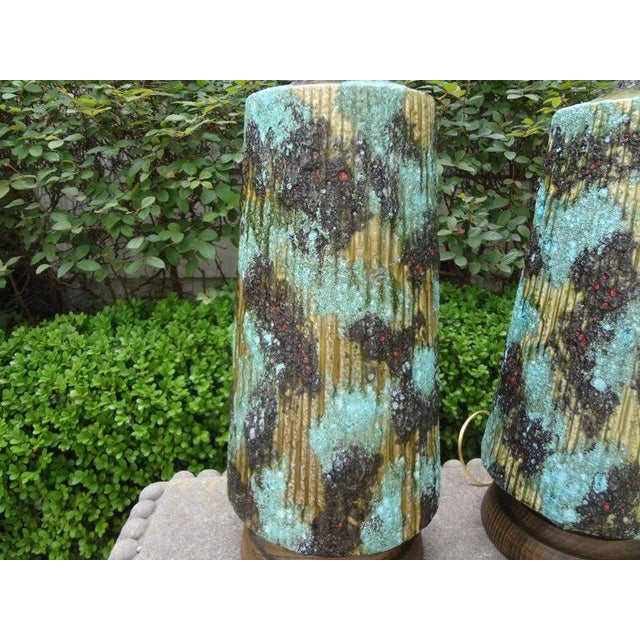 Stunning large pair of Italian glazed ceramic lamps. This unusual pair of Italian lamps are in a gorgeous shade of...