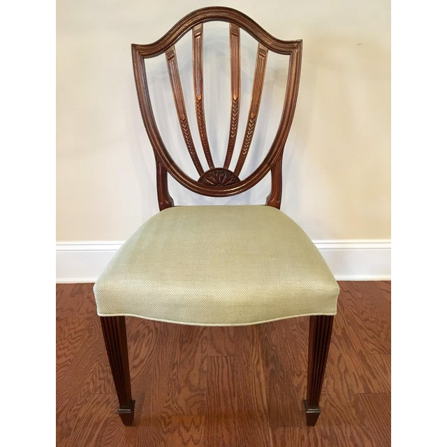 Vintage shield back dining room chairs crafted by Baker. These chairs are from the Historic Charleston Collection. The...