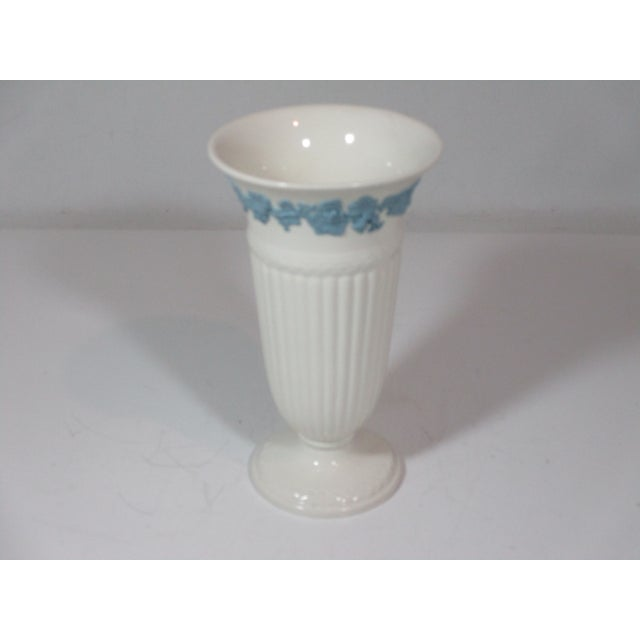 Wedgewood queens ware vase cream footed vase with a power blue embossed grapes and leaves boarder, fluted body and laurel...