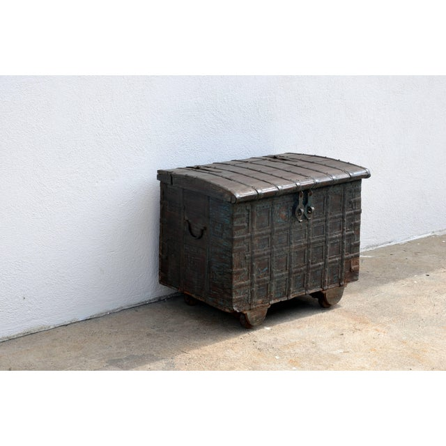 Weathered Bronze Clad Wood Trunk. A very decorative and functional piece.